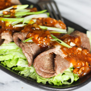 Sliced Beef Over Lettuce