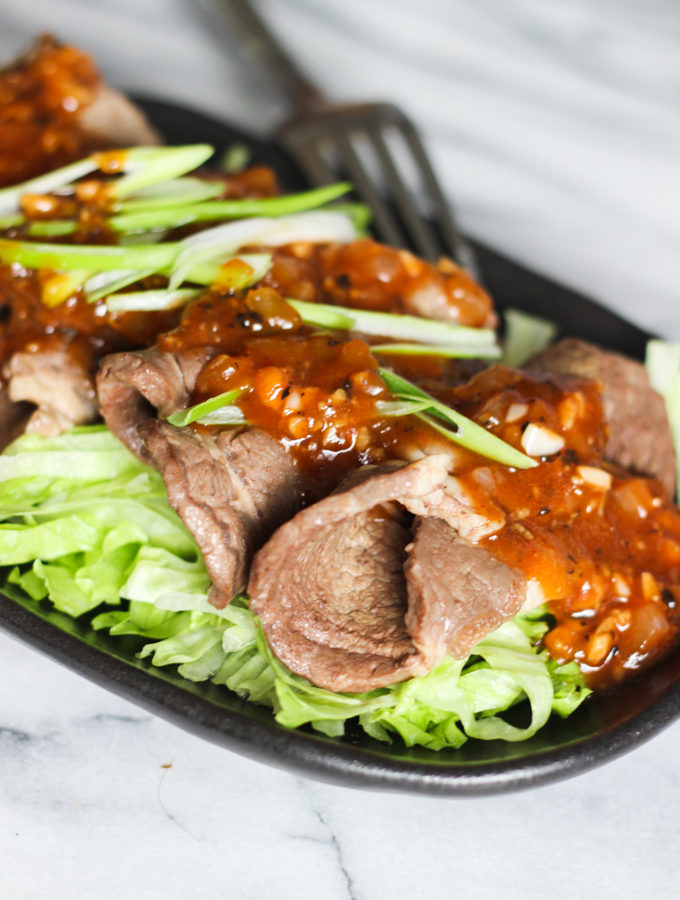 sliced-beef-over-lettuce